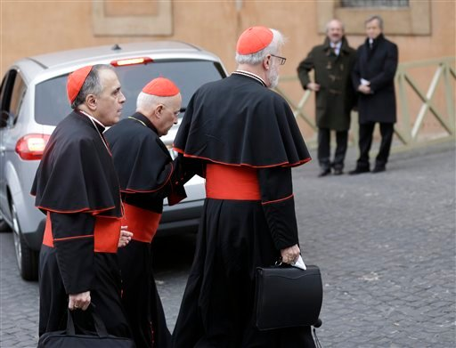 Cardinal Daniel Nicholas DiNardo, left, and Cardinal Sean Patrick O'Malley, right, arrive for a meeting, at the Vatican, Wednesday, March 6, 2013. (AP Photo/Alessandra Tarantino)
