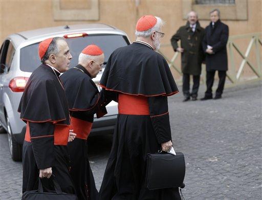 Cardinal Daniel Nicholas DiNardo, left, and Cardinal Sean Patrick O'Malley, right, arrive for a meeting, at the Vatican, Wednesday, March 6, 2013. (AP Photo/Alessandra Tarantino)