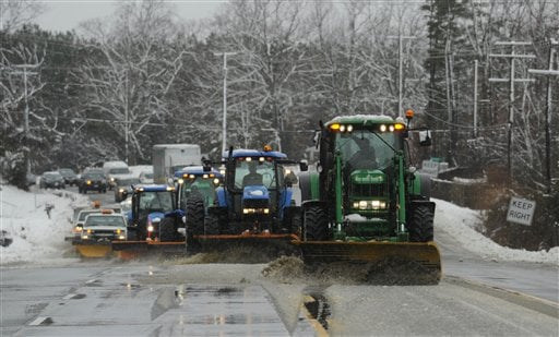 Snowplows clear eastbound Garrisonville Road near North Stafford High School as the first significant snow of the season falls in Stafford County, Va., on Wednesday, March 6, 2013. (AP Photo/The Free Lance-Star, Peter Cihelka)