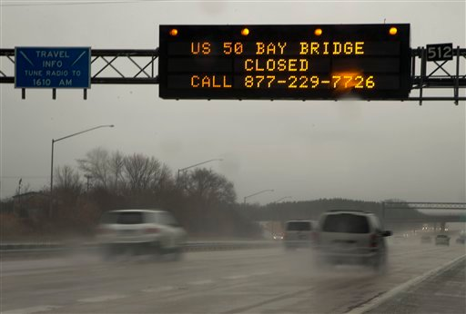 A sign spanning I-97 South in Millersville, Md. March 6, 2013, alerts travelers that the Chesapeake Bay Bridge is closed in both directions because of high winds, according to he Maryland Transportation Authority. (AP Photo/Carolyn Kaster)