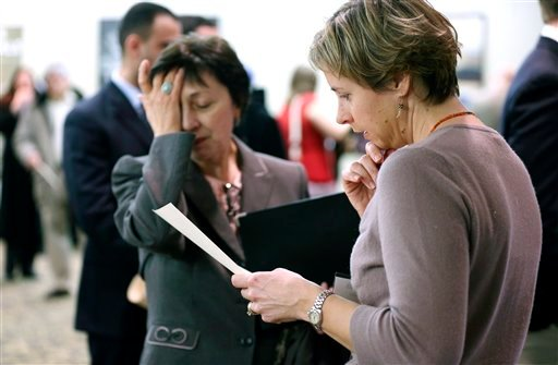 Feb. 25, 2013: Ann Oganesian, left, of Newton, Mass., pauses as she speaks with a State Department employee about job opportunities with the federal government during a job fair in Boston. (AP Photo/Michael Dwyer)