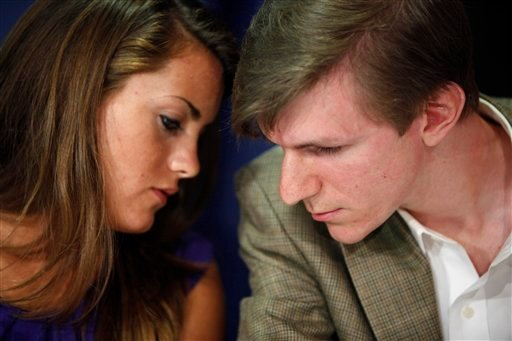 This Oct. 2009 file photo shows Hannah Giles, left, talking with James O'Keefe III during a news conference at the National Press Club in Washington.