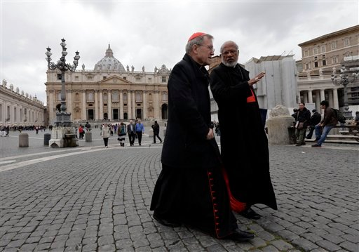 German Cardinal Walter Kasper, left, shares a word with Indian Cardinal George Alencherry in St. Peter's Square following a cardinals' meeting, at the Vatican, Thursday, March 7, 2013. (AP Photo/Alessandra Tarantino)