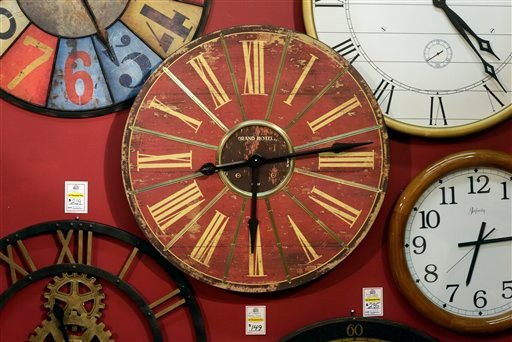 © Clocks hang on a wall in Hands of Time, a clock store and repair shop in Savage, Md., Friday, March 8, 2013.