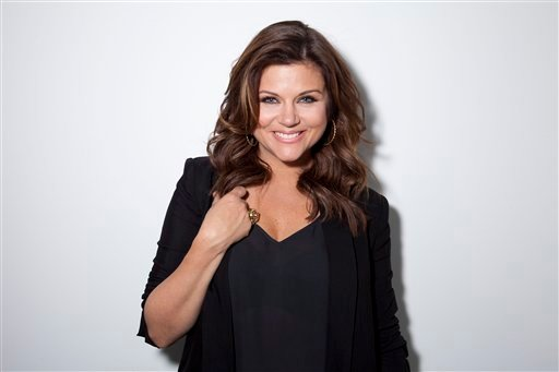 "© This Feb. 6, 2013 file photo shows actress Tiffani Thiessen posing for a portrait in New York. Thiessen, best known for her former role as Kelly Kapowski on TV's ""Saved by the Bell,"" says she had no idea at the time of how popular the show was."
