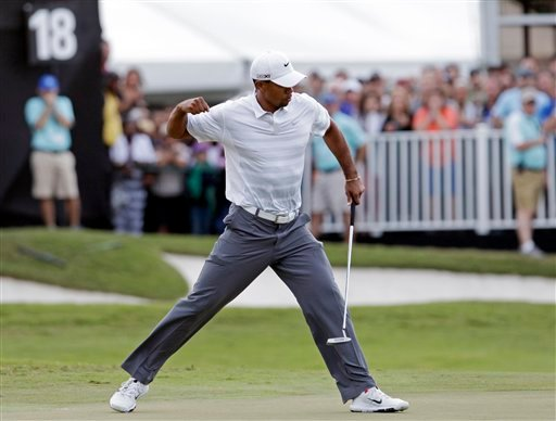 ? Tiger Woods pumps his fist after making birdie putt on the 18th hole during the third round of the Cadillac Championship golf tournament Saturday, March 9, 2013, in Doral, Fla. (AP Photo/Alan Diaz)