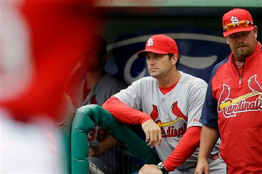 © St. Louis Cardinals manager Mike Matheny, center, watches from the dugout in the eighth inning of an exhibition spring training baseball game against the Boston Red Sox, Tuesday, Feb. 26, 2013, in Fort Myers, Fla. St. Louis won 15-4.