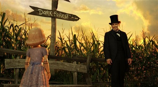"""? This film image released by Disney Enterprises shows the character China Girl, voiced by Joey King, left, and James Franco, as Oz, in a scene from """"Oz the Great and Powerful."""" (AP Photo/Disney Enterprises)"""