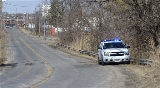 © An Ohio State Patrol vehicle sits along Pine Avenue S.E. in Warren, Ohio, where police say six teens were killed in an accident where the vehicle they were traveling in went off the roadway and into a pond, Sunday, March 10, 2013.