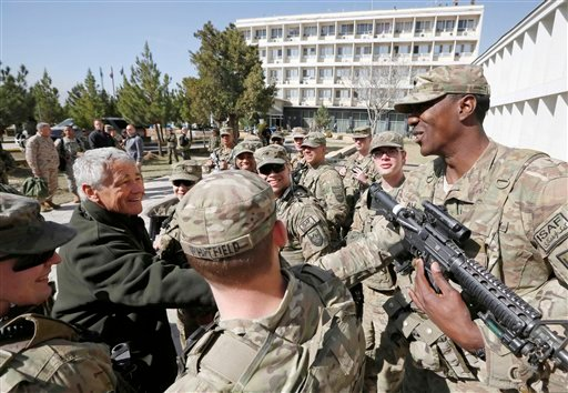 © U.S. Secretary of Defense Chuck Hagel, left, is greeted by members of the U.S. Army and Marines during his visit to the Kabul Military Training Center in Kabul, Afghanistan, Sunday, March 10, 2013.