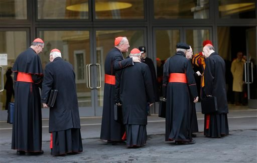 © Cardinals, including U.S. Roger Mahony, left, and Timothy Dolan, third from left, arrive for a meeting at the Vatican, Monday March 11, 2013.