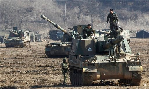 ? South Korean Army soldiers work on their K-9 self-propelled artillery vehicle during an exercise against possible attacks by North Korea near the border village of Panmunjom in Paju, South Korea, Monday, March 11, 2013.