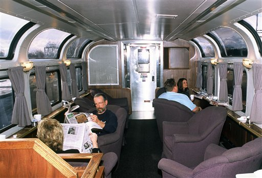 This undated photo provided by Amtrak shows passengers relaxing in a lounge car aboard the California Zephyr, which runs between Emeryville, Calif., and Reno, Nev.