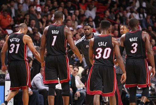 ? LeBron James,center, congratulates Miami Heat teammates Shane Battier (31), Chris Bosh,(1) Norris Cole,(30) and Dwyane Wade,(3) during the fourth quarter of an NBA basketball game at the AmericanAirlines Arena in Miami on Friday, March 8, 2013.