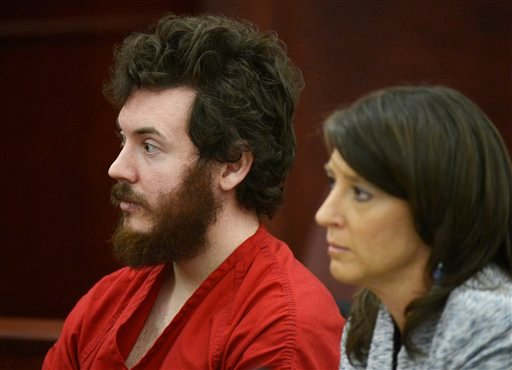 © James Holmes sits with defense attorney Tamara Brady during his arraignment in district court in Centennial, Colo., on Tuesday, March 12, 2013.