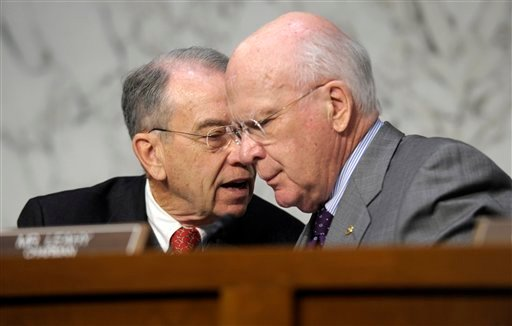 ? In this Feb. 13, 2013 file photo, Senate Judiciary Committee Chairman Sen. Patrick Leahy, D-Vt., right, talks with the committee's ranking Republican Sen. Charles Grassley, R-Iowa, on Capitol Hill in Washington.