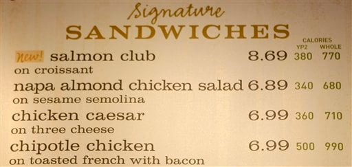 © In this March 8, 2010 file photo, the sandwich board at the Panera store in Brookline, Mass shows the calorie count for each item.