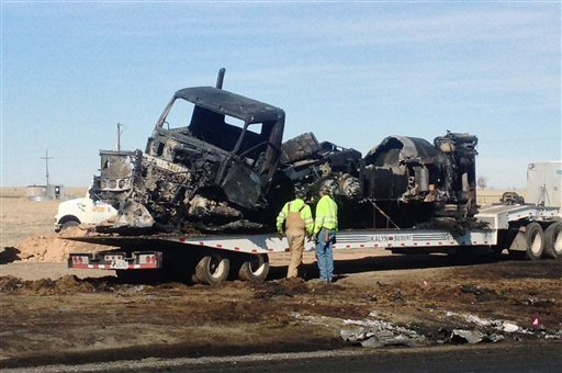 This photo, courtesy of KFDA NewsChannel 10 Amarillo shows the charred remains Monday, March 11, 2013, after a fatal wreck Sunday between a tanker loaded with fuel and a car with five teens near Dumas, Texas. (AP)