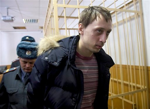 Pavel Dmitrichenko, foreground, is escorted out of a courtroom in Moscow, Russia, on Thursday, March 7, 2013. (AP)