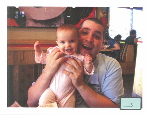 This undated file photo submitted into evidence by defense attorney Julia L. Gatto shows New York City police Officer Gilberto Valle with his daughter. (AP Photo/Provided by Attorney Julia L. Gatto, File)
