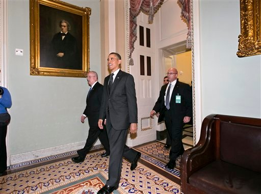 President Barack Obama leaves the Capitol in Washington, after visiting with Senate Democrats in in the first of four meetings with lawmakers this week to discuss the budget, Tuesday, March 12, 2013. (AP Photo/J. Scott Applewhite)