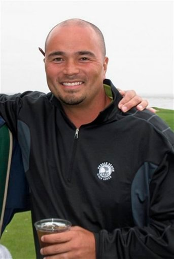 This 2011 cell phone image provided by golfmanna.com, shows Mark Mihal, 43, a mortgage broker from Creve Couer, Mo., during a golf outing at the Pebble Beach Golf Links in Pebble Beach, Calif.