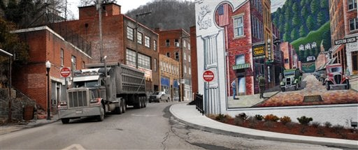 In this Feb. 9, 2011, file photo, a coal truck drives out of downtown Welch, W.Va.  (AP Photo/Jon C. Hancock, File)