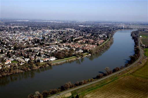 This Feb. 22, 2006 file photo shows houses located in the Pocket Area of Sacramento, Calif. along the Sacramento River. (AP)