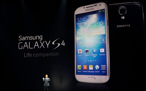 ? JK Shin, President and Head of IT and Mobile Communications for Samsung Electronics, presents the new Samsung Galaxy S 4 during the Samsung Unpacked event at Radio City Music Hall, Thursday, March 14, 2013 in New York.