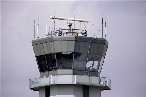 This March 12, 2013 photo shows the air traffic control tower at Chicago's Midway International Airport. (AP)