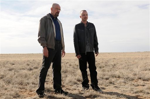 "FILE - This file image released by AMC shows Bryan Cranston as Walter White, left, and Aaron Paul as Jesse Pinkman in a scene from the season 5 premiere of ""Breaking Bad."" (AP)"