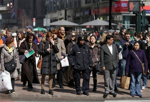 © In this photo taken March 13, 2013, pedestrians wait to cross a New York street. An historic decline in the number of U.S. whites and the fast growth of Latinos are blurring traditional black-white color lines in the U.S.