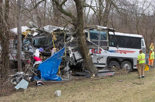  Authorities investigate a passenger bus crash on the Pennsylvania Turnpike on Saturday, March 16, 2013 near Carlisle, Pa.