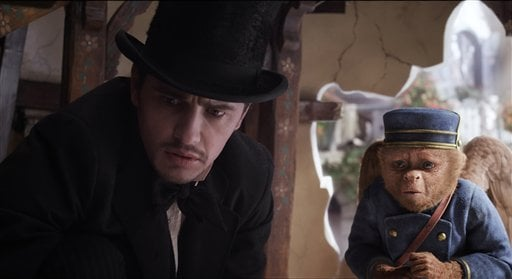 """© This file film image provided by Disney Enterprises shows James Franco, as Oz, left, and the character Finley, voiced by Zach Braff, in a scene from """"Oz the Great and Powerful."""""""