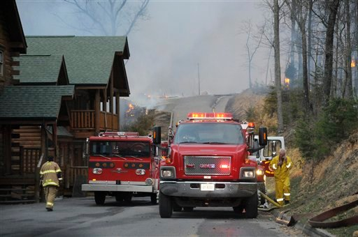 ? Fire crews try to keep a contain on large fire on Black Bear Cub Way in Sevier County Tenn., Sunday March 17, 2013. By 8:00 p.m. 32 cabins were reported burned and another 40 in danger. (AP Photo/The Mountain Press, Curt Habraken)