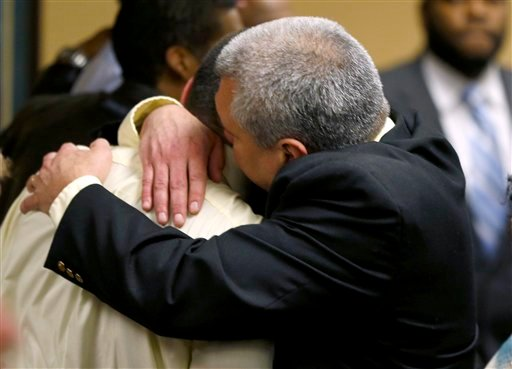 ? Trent Mays, 17, left, gets a hug from his father, Brian Mays, after Trent and co-defendant Ma'Lik Richmond, 16, were found delinquent on rape and other charges after their trial in juvenile court in Steubenville, Ohio, Sunday, March 17, 2013.