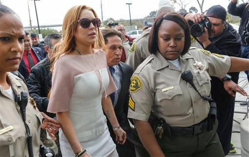 Actress Lindsay Lohan arrives at the Los Angeles Superior court Monday, March 18, 2013. (AP)