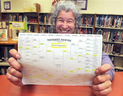 FILE - In this March 31, 2011 file photo, Jefferson High School librarian Diana Inch displays her winning NCAA tournament bracket from Yahoo.com's online contest in Jefferson, Ore. (AP)
