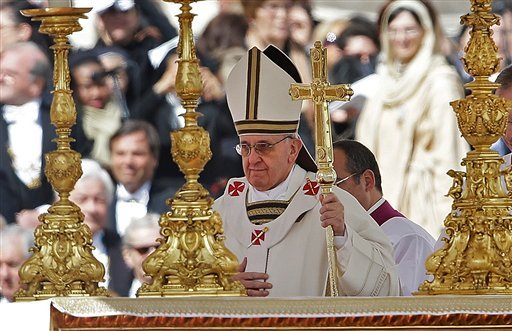 ? Pope Francis walks past the alter in front of St. Peter's Basilica in St. Peter's Square following his inauguration Mass at the Vatican, Tuesday, March 19, 2013. (AP Photo/Gregorio Borgia)