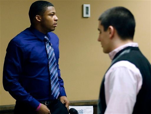Ma'lik Richmond, 16, left, and co-defendant Trent Mays, 17, right, walks around in the court room during a break on the fourth day of their trial on rape charges in juvenile court on Saturday, March 16, 2013 in Steubenville, Ohio. (AP)