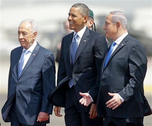 President Obama is greeted by Israeli President Shimon Perez, left, and Israeli Prime Minister Benjamin Netanyahu upon his arrival ceremony at Ben Gurion International Airport in Tel Aviv, Israel March 20, 2013, (AP Photo/Pablo Martinez Monsivais)