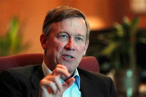 In this Dec. 12, 2012 file photo, Colorado Gov. John Hickenlooper is pictured during an interview with the Associated Press at his office in the Capitol in Denver. (AP Photo/Ed Andrieski, File)