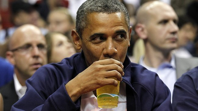 US President Barack Obama, seen here at a Team USA v Brazil basketball game, has picked the Indiana Hoosiers to triumph in this year's college basketball tournament.