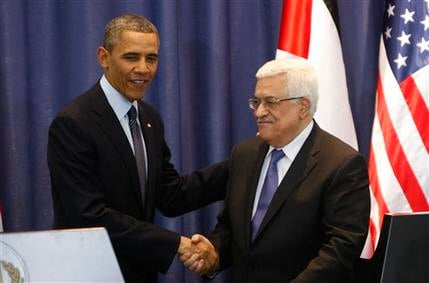President Obama shakes hands with Palestinian President Mahmoud Abbas during a joint press conference in the West Bank city of Ramallah March 21, 2013. (AP Photo/Majdi Mohammed)