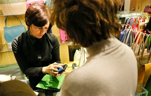 In this Friday, Feb. 15, 2013, photo, a sales staff member at Barney's New York uses an iPod Touch to help a customer make a purchase, in New York. (AP)