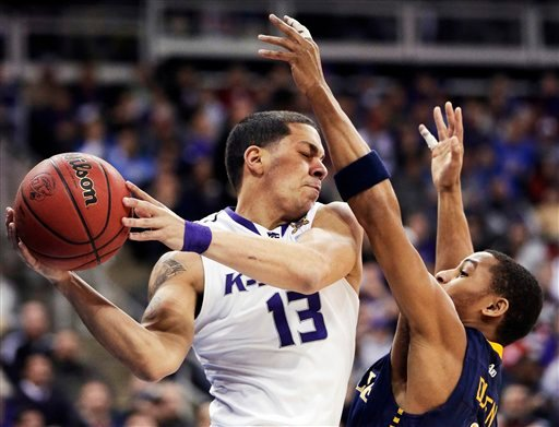 Kansas State guard Angel Rodriguez (13) is covered by La Salle guard Tyreek Duren (3) during the first half of a second-round game in the NCAA college basketball tournament at the Sprint Center in Kansas City, Mo., Friday, March 22, 2013. (AP Photo/Orlin)