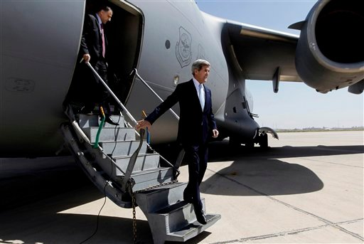 ? U.S. Secretary of State John Kerry, right, arrives to meet with Iraq's Prime Minister Nouri al-Maliki, not pictured, in Baghdad, Iraq, Sunday, March 24, 2013.