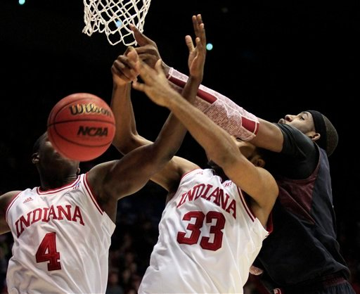 ? Temple forward Anthony Lee, right, reaches over Indiana forward Jeremy Hollowell (33) and guard Victor Oladipo (4) in the first half of a third-round game of the NCAA college basketball tournament Sunday March 24, 2013, in Dayton, Ohio.