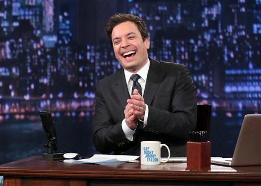 """? This Feb. 21, 2013 photo released by NBC shows Jimmy Fallon, host of """"Late Night with Jimmy Fallon,"""" on the set in New York."""