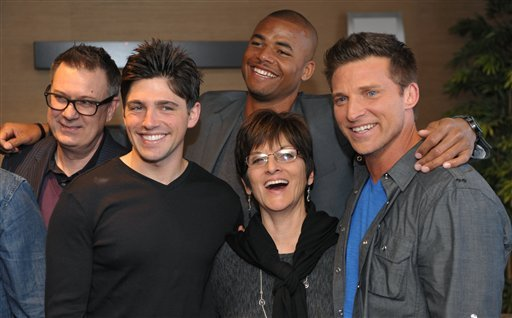 """Jill Farren Phelps, second from right, executive producer of """"The Young and the Restless,"""" poses with, from left, the show's head writer Josh Griffith and cast members from """"The Young and the Restless."""" (AP)"""